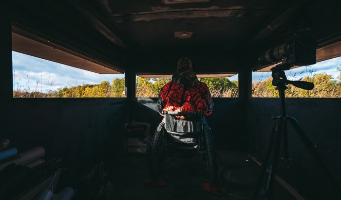 Hunter in wheelchair accessible deer blind