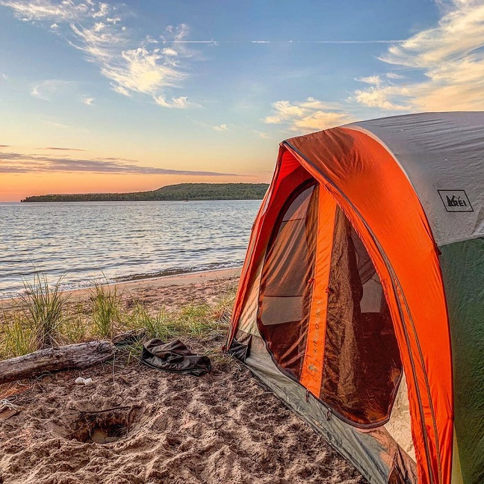 Tent on shore in Munising at sunset