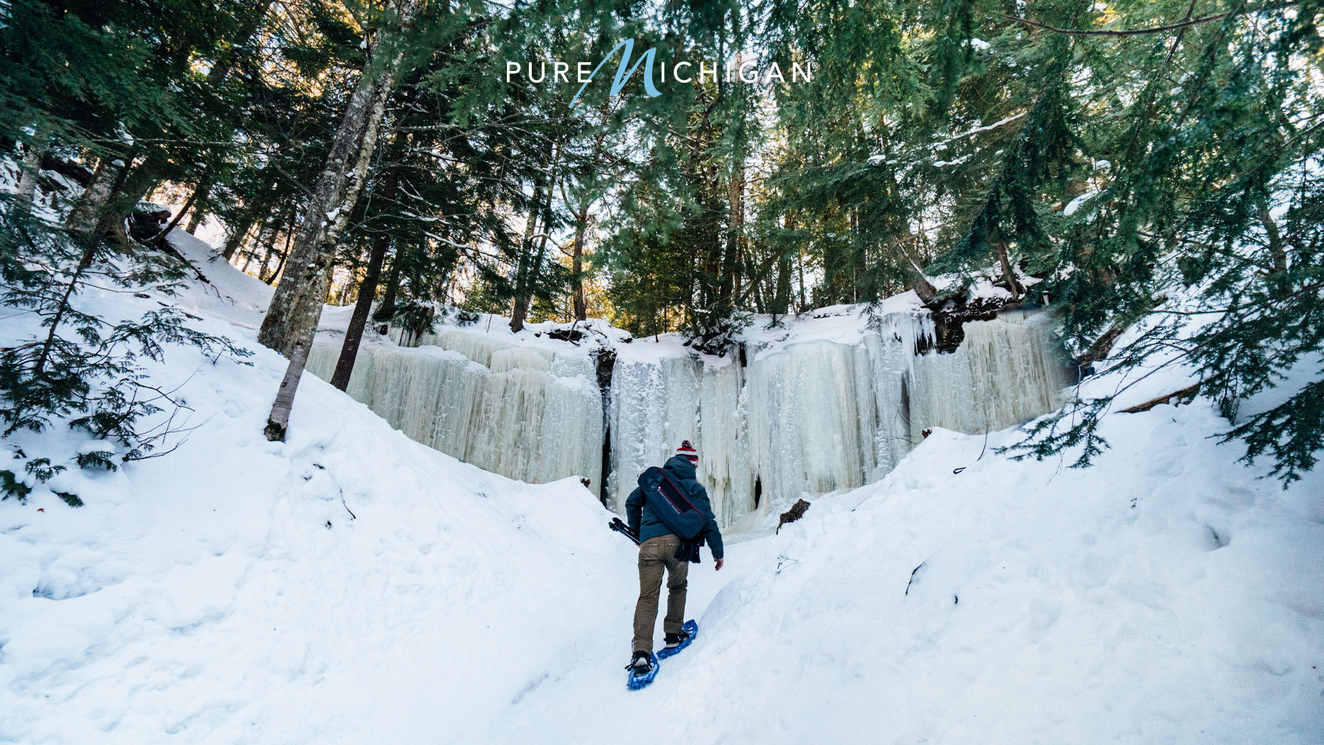 Hiker exploring the Eben Ice Caves