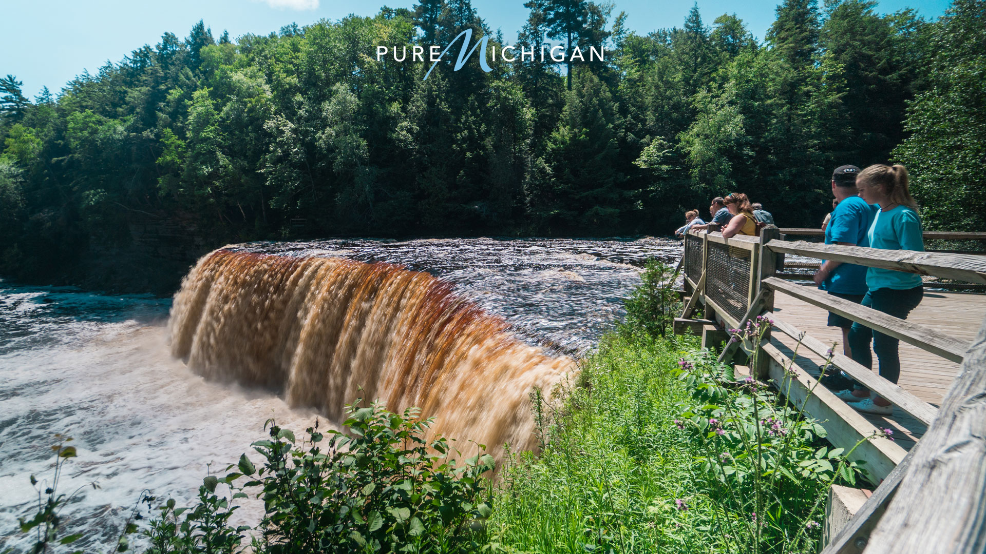 People on observation deck beside Tahquamenon Falls